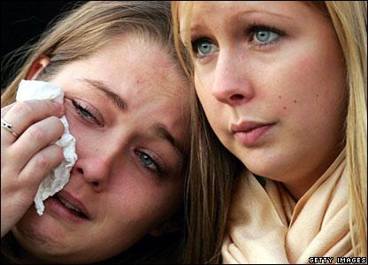 Tearful women watch July bombs memorial service