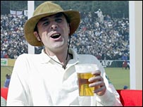 Phil Tufnell enjoys a pint while watching cricket in 2003