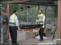 Israeli recovery workers remove body of woman killed in rocket attack