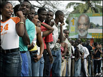 Haitians line up to vote in a suburb of the capital, Port-au-Prince