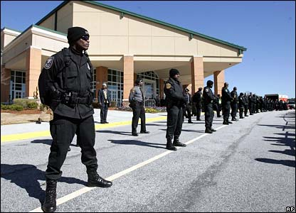 Police officers outside the New Birth Missionary Baptist Church