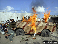 Hamas supporters set fire to a Palestinian police armoured vehicle