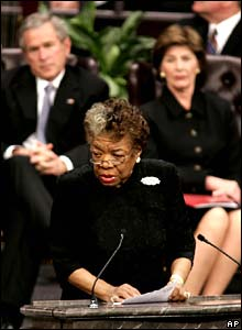 Writer Maya Angelou, in the background President Bush and First Lady Laura Bush