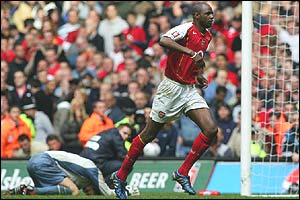 Vieira wheels away after putting the decisive penalty past Man United keeper Roy Carroll