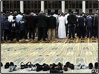 British Muslims perform their traditional Friday prayers