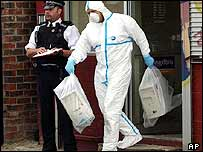 Forensic officer removes computers