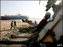 Indian workers dismantle decommissioned ships at a ship breaking yard in Alang.