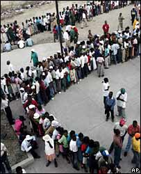Residents of a slum line up to cast their vote in Port-au-Prince, Haiti