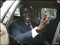 Former Senegalese PM Idrissa Seck, waving as he goes for police questioning