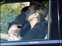 Britney Spears driving while holding baby