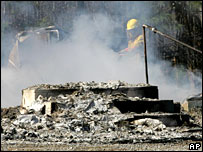 A firefighter surveys the remains of the Morning Star Baptist Church, Alabama