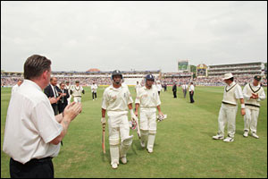 Thorpe and Hussain are applauded off the field in 1997