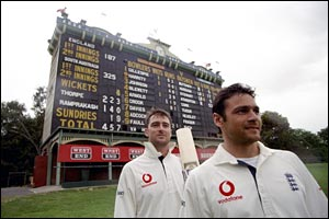 Thorpe and fifth-wicket partner Mark Ramprakash stand in front of the scoreboard