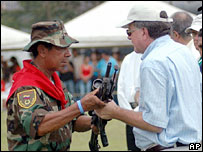 Paramilitary fighter Ramon Isaza hands over his weapons in Colombia