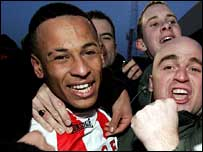 DJ Campbell celebrates with fans after his goals knocked Sunderland out of the FA Cup