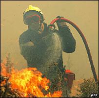 Firefighter tackling forest fire near Coudoux, Bouches-du-Rhône, 1 July 05