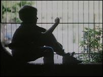 Boy by railing