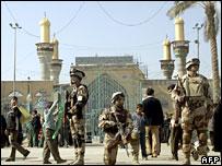 Iraqi soldiers stand guard in Kadhimiya