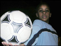 Boy holds a football