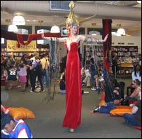 Stilt walker in New York bookshop