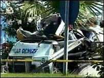 TV grab of remains of minibus after explosion
