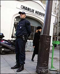 Police guard the French headquarters of Charlie Hebdo