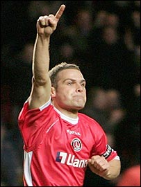 Luke Young celebrates his goal against Liverpool which put Charlton up 2-0