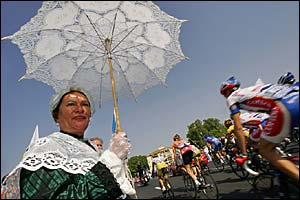 A spectator in fancy dress watches the Tour