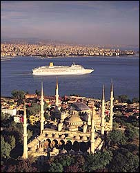 A cruise liner passes through the Bosporus at Istanbul