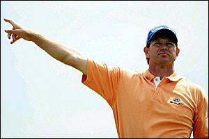 Retief Goosen hits a wayward tee shot