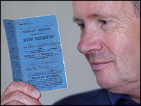 Colin Hall, custodian of Mendips, holding Lennon's Sunday School Attendance Card