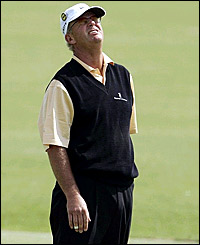 Home favourite Sandy Lyle misses a birdie putt at the first
