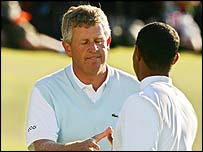 Colin Montgomerie and Tiger Woods shake hands on the 18th