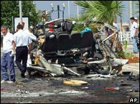 Wreckage of minibus after explosion
