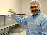 Scientist holding sample of comet material (Open University)
