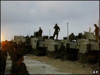 Israeli soldiers gather at a staging area near the Jewish settlement of Ganei Tal, central Gaza Strip on Saturday