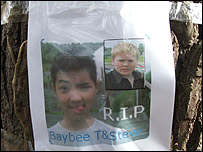 A memorial poster pinned to a tree
