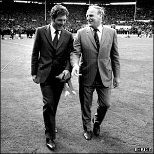 West Ham general manager Ron Greenwood (right) and manager John Lyall walk across Wembley after their team 2-0  FA Cup final win in 1975