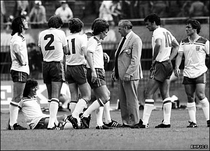 England manager Ron Greenwood (in suit) gives a team talk to (l-r) Dave Watson, Phil Neal, Tony Woodcock, Phil Thompson (hidden), Steve Coppell, Trevor Brooking and Kenny Sansom