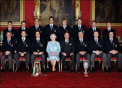 The England cricket team pose for a photo with the Queen