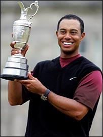Tiger Woods revels in his 10th major success