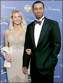Woods, with wife Elin