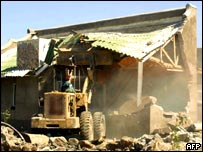 Zimbabwe house being destroyed by a bulldozer