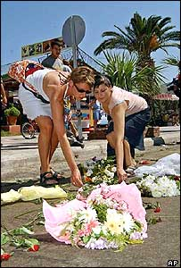 Local and foreign tourists put flowers at the bombing scene in Kusadasi