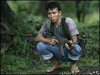 Acehnese fighter holding a gun