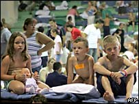 Children in an emergency shelter in a gym at Lasalle University, Cancun