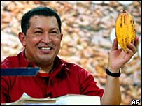 President Hugo Chavez holds a cacao plant on his weekly TV show