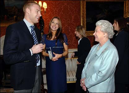 Andrew Flintoff and his wife, Rachel, enjoy a drink with Her Majesty