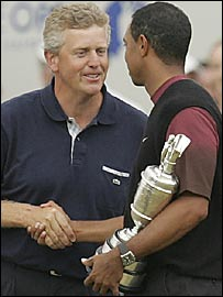 Colin Montgomerie congratulates Tiger Woods after finishing second at the Open
