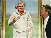 Shane Warne poses with his portrait, which will hang in the Long Room at Lord's